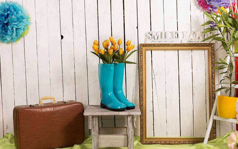 Spring background with wellington boots and flowers